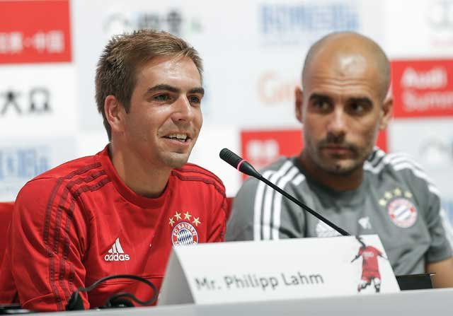 Philipp Lahm y Pep Guardiola