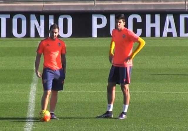 Rafa Mir, junto a Paco Alcácer
