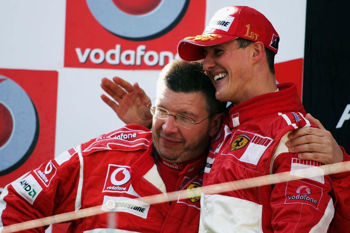 Ross Brawn y Michael Schumacher en el podio