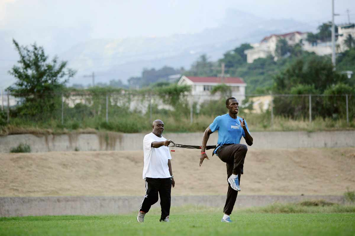 Usain Bolt y Glen Mills