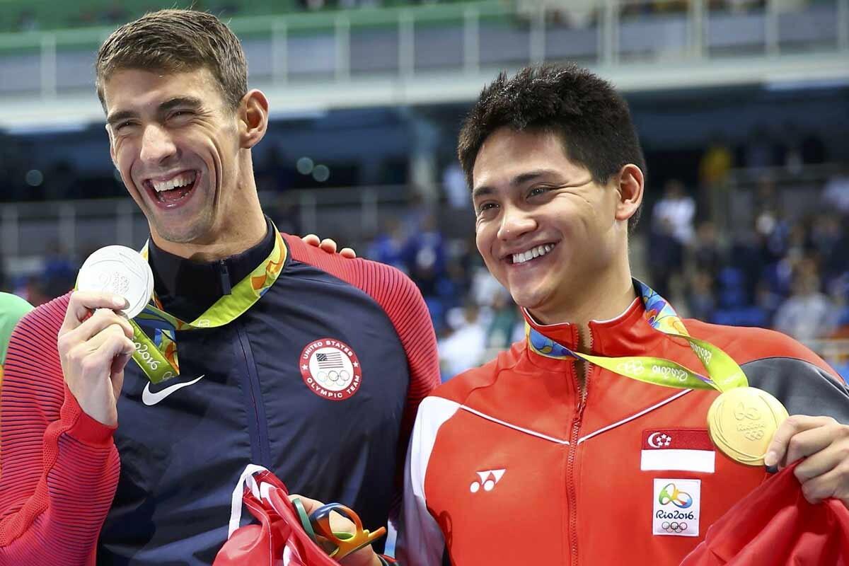 Joseph Schooling y Michael Phelps