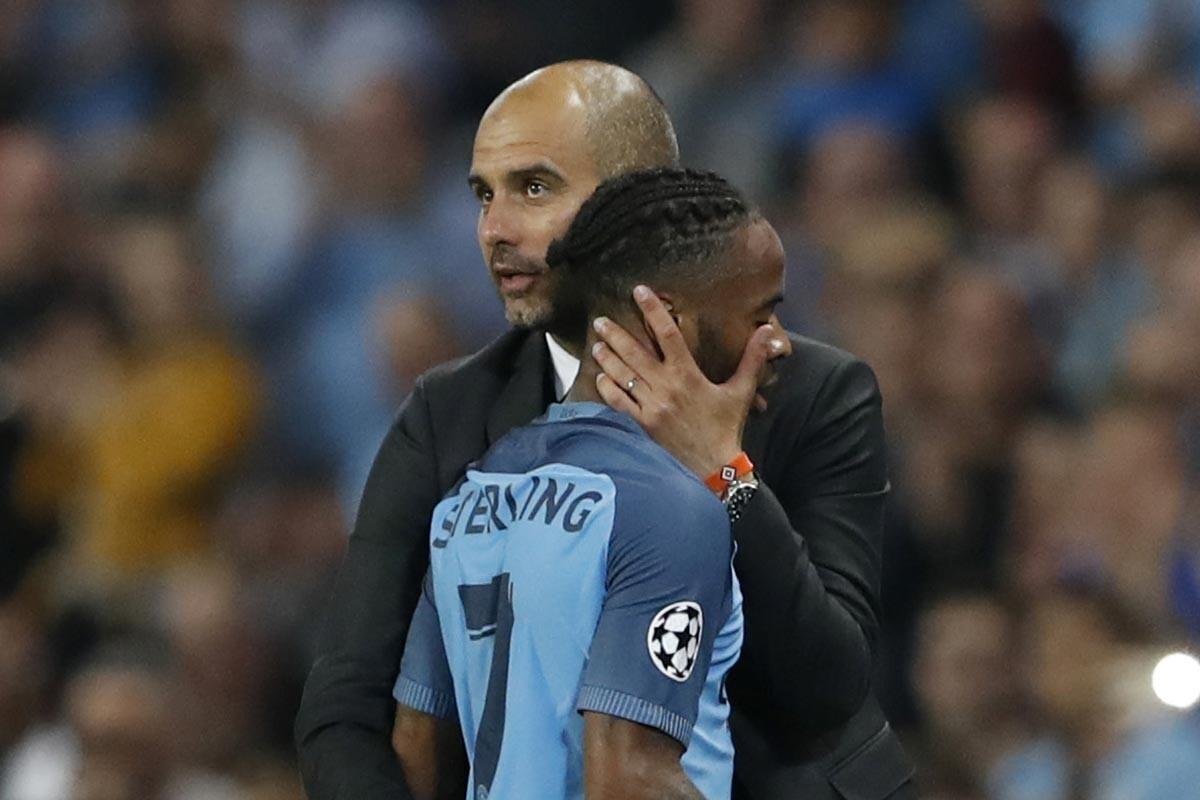 Raheem Sterling y Pep Guardiola