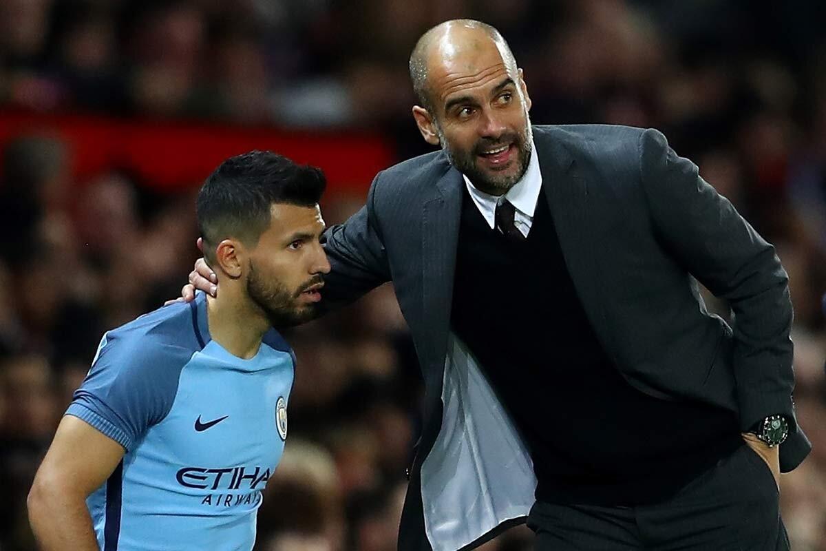 Sergio Aguero y Pep Guardiola, del Manchester City