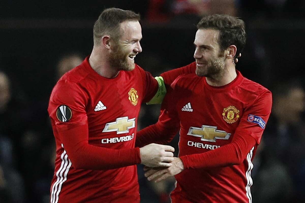 Wayne Rooney y Juan Mata