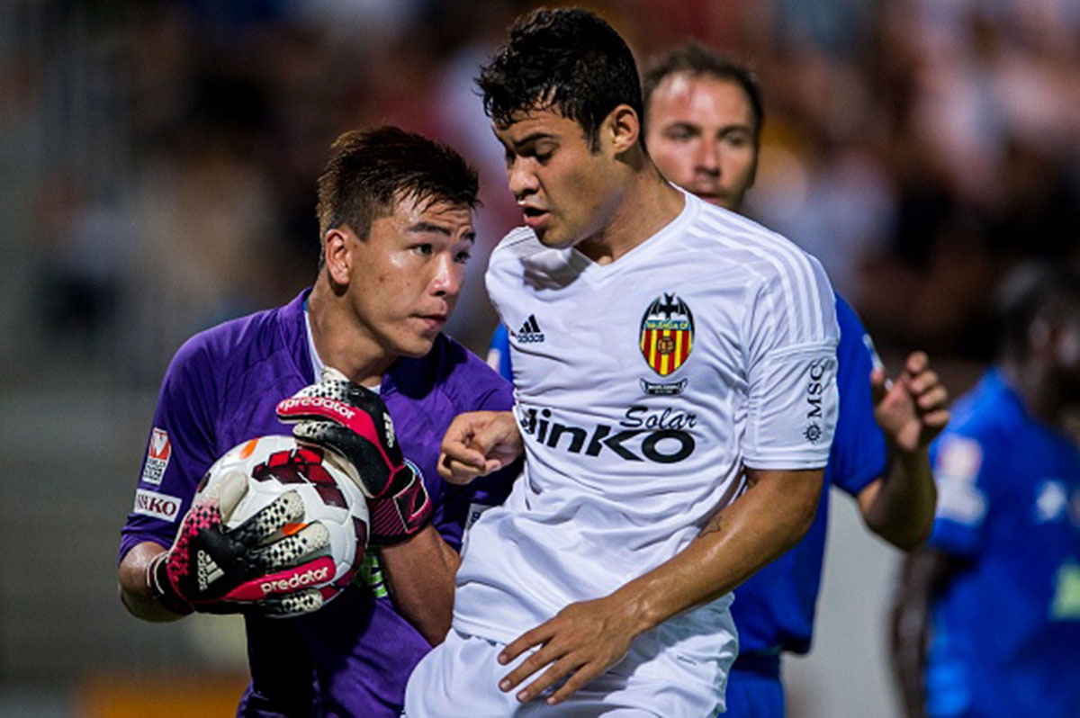 (R) Vinicius Araujo of Valencia CF competes for the ball with (L) Hing Kit Leung of BC Ranger FC during LFP World Challenge 2014 between Valencia CF vs BC Rangers FC on May 28, 2014 at the Mongkok Stadium in Hong Kong, China. Photo by Victor Fraile (Photo by Victor Fraile/Corbis via Getty Images)