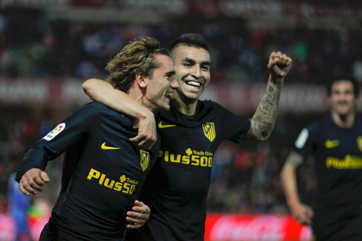 Griezmann y Correa ante el Granada